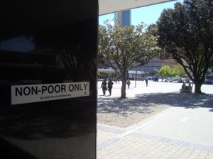 Prior to the FIFA World Cup In South Africa in 2010, informal traders were evicted from the Cape Town Railway Station using a new by-law introduced by the City of Cape Town. The station was renovated and its adjacent outdoor space once used by the traders was 'cleaned up', landscaped, with just a single bench installed. This was designed and produced by an artist commissioned by the city. The traders fought the eviction, marched to parliament but lost their fight against the eviction. Today no trading is allowed in this 'sanitized' space and the space is bereft of informal traders and policed by security companies